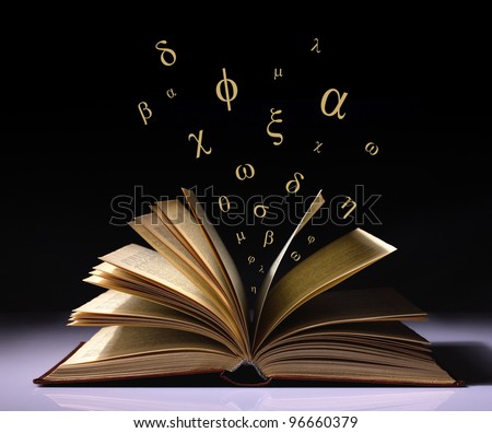 opened old book with flying greek letters on black and white background - stock photo