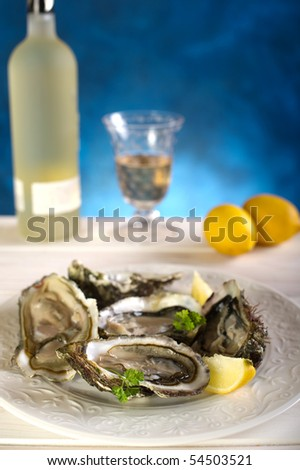 opened oyster on dish - stock photo