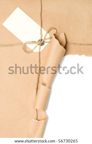Opened parcel tied with string with blank label, copy space included within torn section - stock photo