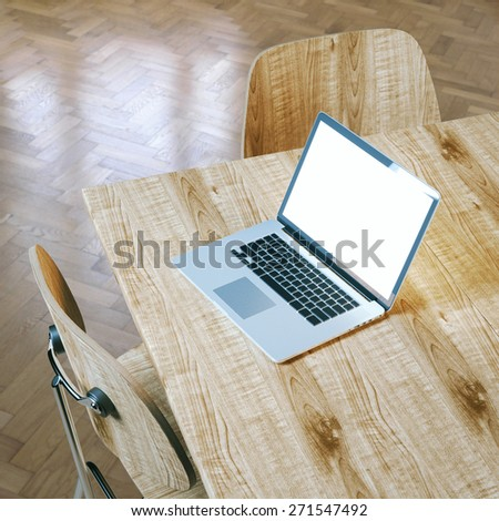 Opened pc laptop on wooden table. Detail of interior with chairs and laminate flooring. Picture for business or office advertising. - stock photo