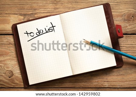 Opened personal organizer with a to do list. - stock photo