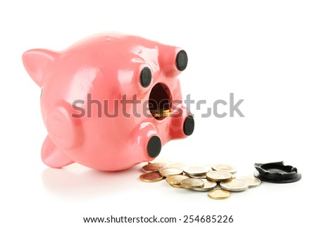 Opened piggy bank with coins, isolated on white - stock photo