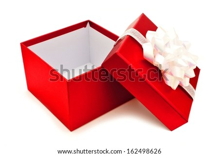Opened red Christmas gift box with white bow and ribbon