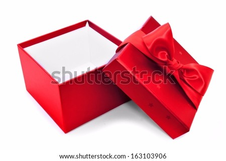 Opened red gift box with bow over a white background - stock photo