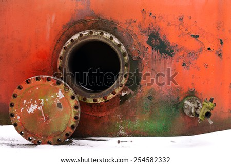 opened rusty manhole on the red fuel tank - stock photo