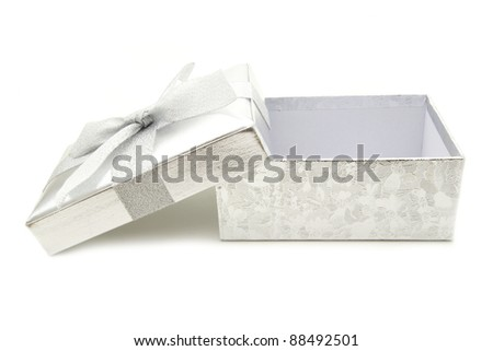Opened silver gift box with lid and bow over white - stock photo