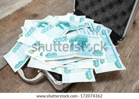 Opened steel case with Russian rubles inside - stock photo