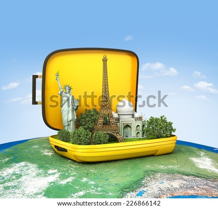 Opened suitcase with world famous monuments inside. Unusual traveling concept.  - stock photo