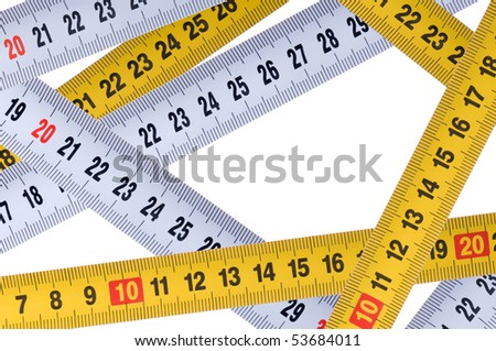 Opened tape measure on white isolated background - stock photo