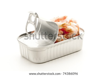 Opened tinned shrimps ready to be eaten. - stock photo
