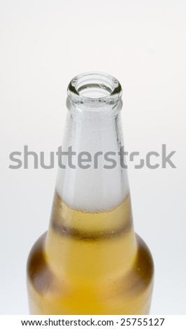 Opened  wet cold light  beer bottle with fresh froth - stock photo