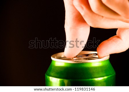 opening a can of beer - stock photo