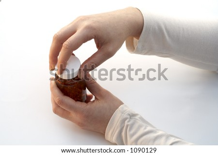 Opening a medicine bottle - stock photo