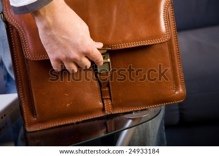 Opening brown leather bag - stock photo