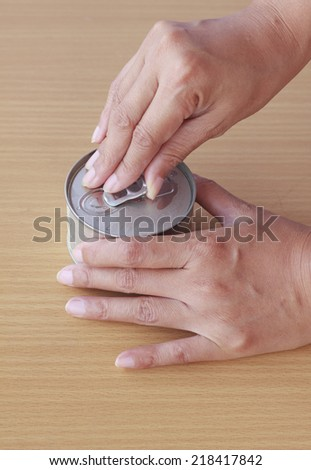Opening Can - Stock Image