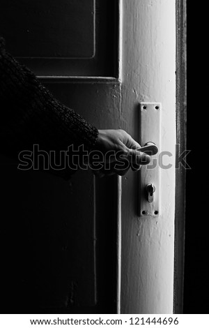 Opening door into light unknown room. Black and white style. - stock photo