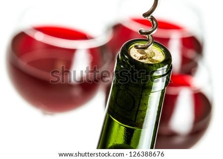 Opening green wine bottle - stock photo