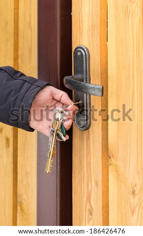 opening home door by bunch of keys close up - stock photo