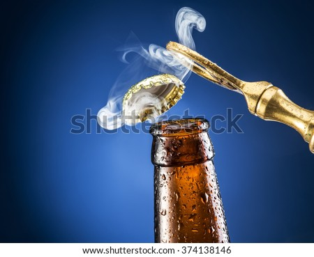 Opening of beer cap with the gas output. - stock photo