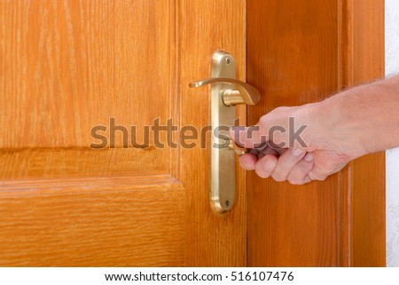 Opening or closing a safety lock on a wooden door