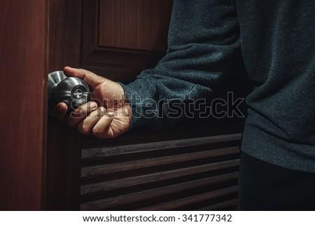 opening the door at night - stock photo