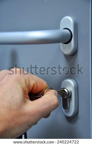 Opening the door lock - stock photo