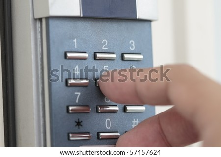 Opening the door with number combination with woman hand.