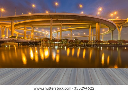 Opening wooden floor, Highway overpass with water reflection at night  - stock photo
