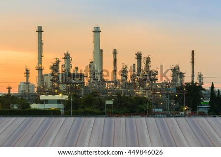 Opening wooden floor, Oil refinery with sunrise sky background