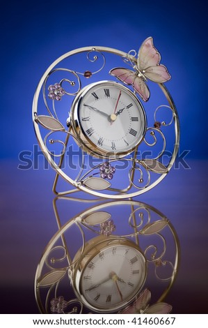 Openwork, beautiful hours on a mirror table - stock photo