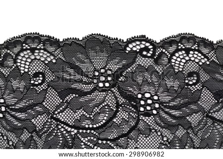 Openwork black beautiful lace on a white background.