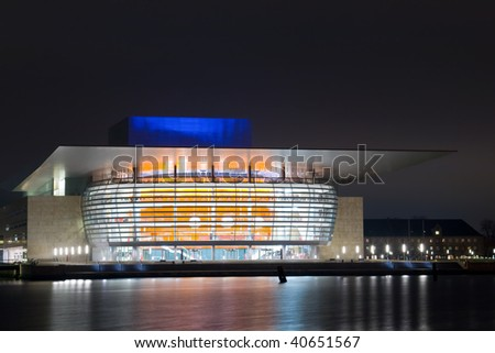 Opera house on the bank of the river - stock photo