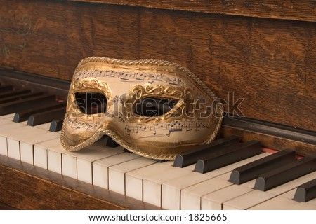 Opera Mask on Piano Keyboard