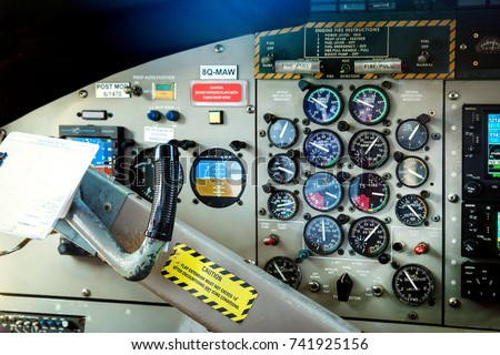 Operate an instrument panel. Interior details of a water plane.