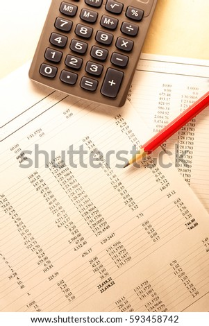 Operating budget, calculator and pencil in closeup