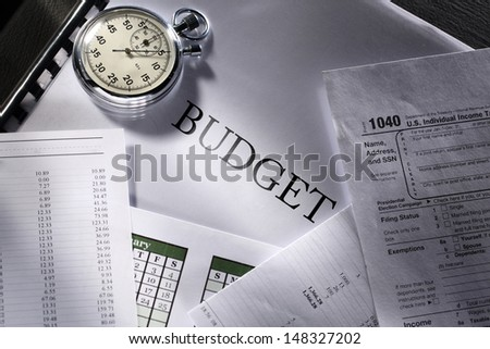 Operating budget, calendar and stopwatch - stock photo