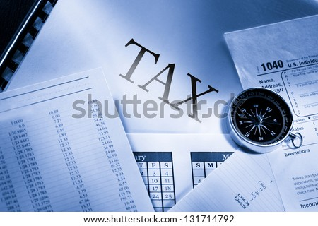 Operating budget, calendar, compass and tax - stock photo