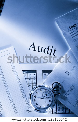 Operating budget, calendar, stopwatch and audit - stock photo
