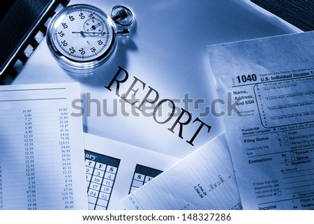 Operating budget, calendar, stopwatch and report - stock photo