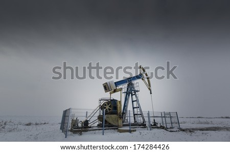 Operating oil and gas well isolated on white and grey background