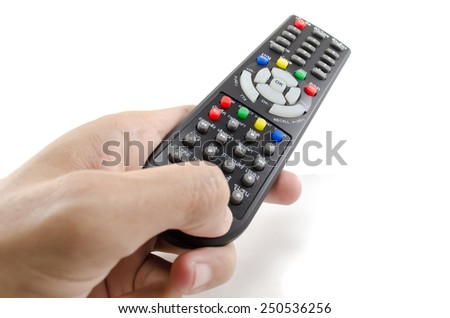 Operating remote control for Thai TV - stock photo
