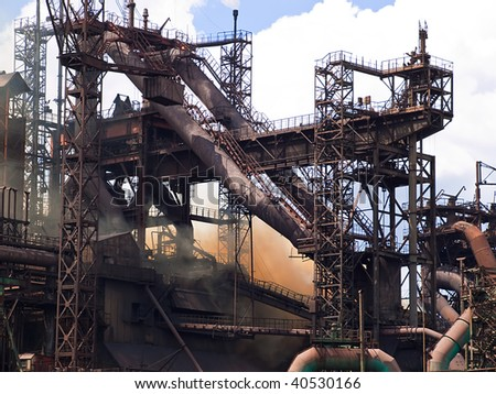 Operation of a metallurgical plant against the sky - stock photo