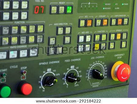 Operation panel of CNC machine. Selective focus. - stock photo