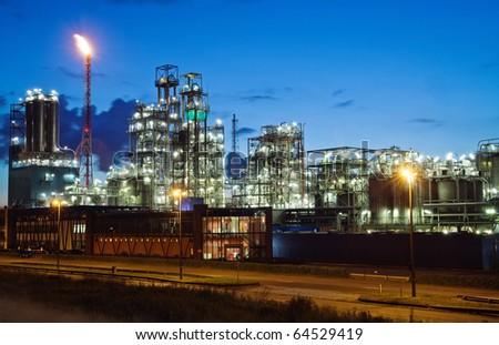 Operational petrochemical plant in twilight (Antwerp port, Belgium) - stock photo