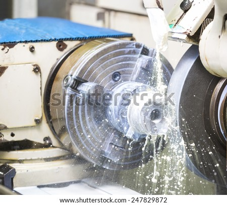operator grinding forging dieoperator grinding forging die parts by high precision grinding machine parts by high precision grinding machine - stock photo