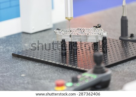operator inspection aluminum automotive parts by CMM - stock photo