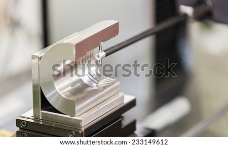operator inspection automotive part by contour measuring machine - stock photo