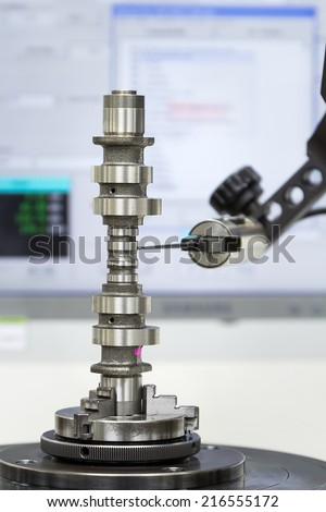 operator inspection cylindrical of camshaft by roundness tester - stock photo