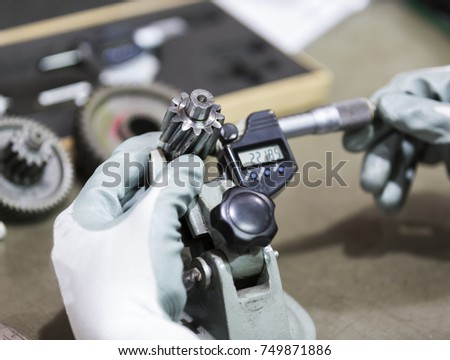 operator inspection high precision automotive part by micrometer