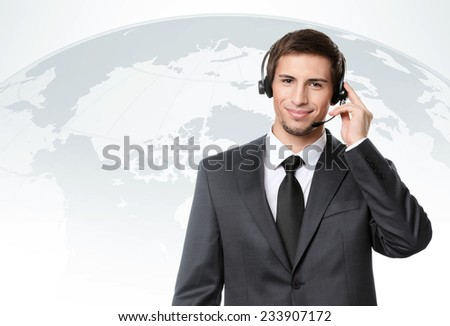 Operator puts earphones with microphone, international talks - stock photo